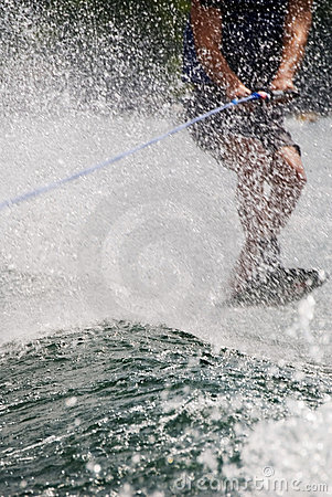 Trick Skier Behind Water Spray