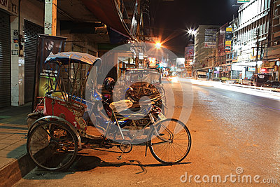 Tricycle bicycle parks on the urban street at nigh Editorial Photography