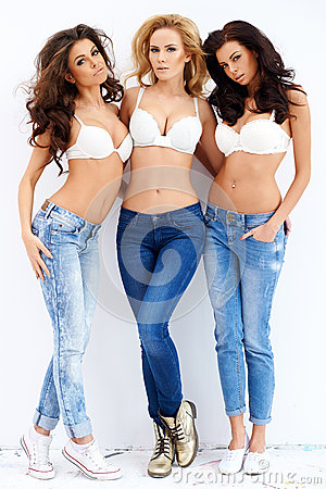 Free Trio Of Sexy Shapely Women In Jeans And Bras Stock Photography - 39878752