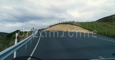 A trip along a winding road through the hills near the shore with rocks. stock footage