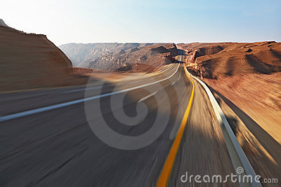 Trip driving on high speed in stone desert