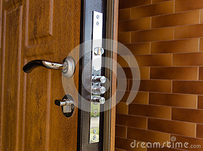 Triple Cylinders On A New High Security Lock Stock Photo