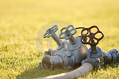 Triple faucet on the grass