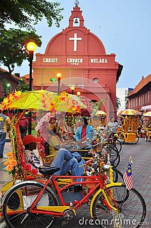 Trishaw peddler in Melaka Editorial Photography