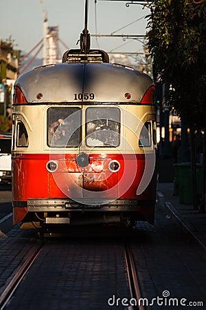 Trolley car gleams in sunlight in San Francisco street