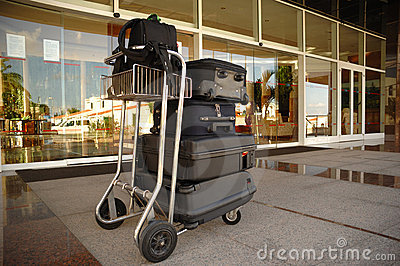 Trolley with suitcases at hotel