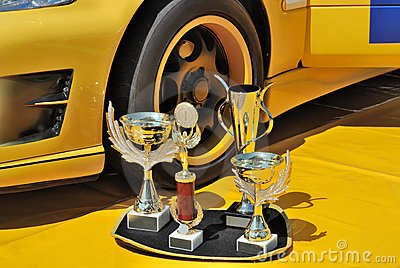 Auto Racing Trophies on Free Stock Image  Trophies And Yellow Racing Car  Image  10514576