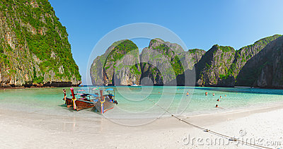 Tropical beach with boats and rocks. Thailand, Phi Phi