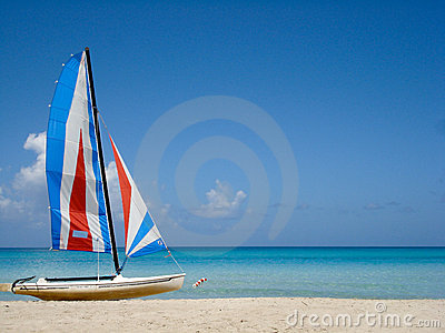 Tropical beach with colorful boat