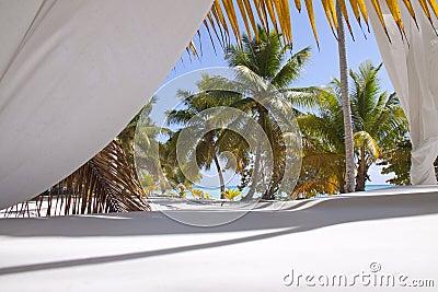 Tropical beach with curtains