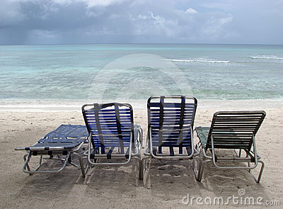 Tropical beach and deck chairs