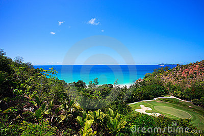 Tropical beach and golf field