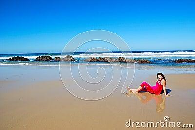 Woman lying on beach