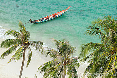 Tropical beach and rowboat