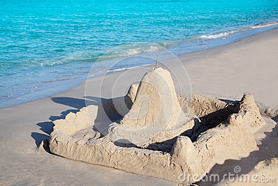 Tropical beach with sand castle
