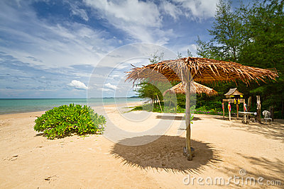 Tropical beach scenery with parasol