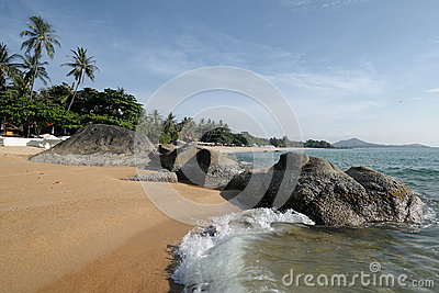 Tropical beach with stones