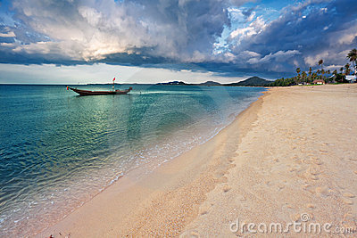 Tropical beach under gloomy sky