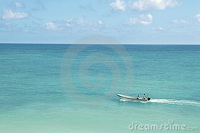 Tropical caribbean sea with boat on turquoise