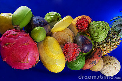 Tropical fruits on blue background