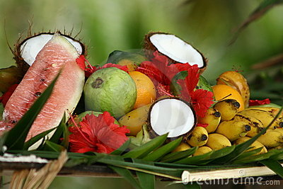 Tropical fruits and flowers arrangement