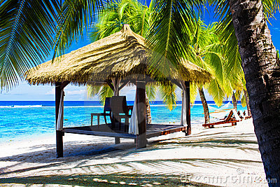 Tropical gazebo with chairs on a beach