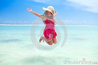 Tropical girl with frangipani flower