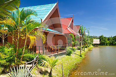 Tropical holiday houses at the lake