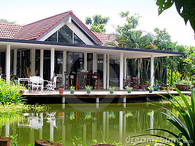 Tropical house veranda & natural pond