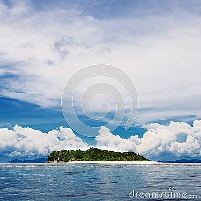 Tropical island beach with perfect sky