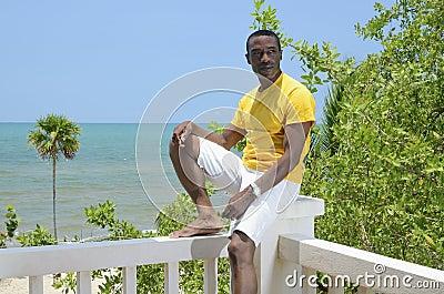 Tropical man in yellow shirt
