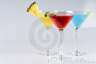 Tropical Martini style drinks with fruit & garnish