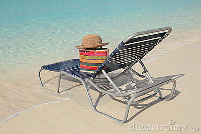 Tropical ocean beach and straw hat