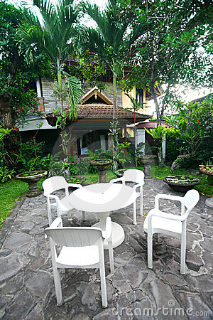 Tropical resort garden with furniture