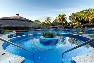 Tropical resort at swimming pool