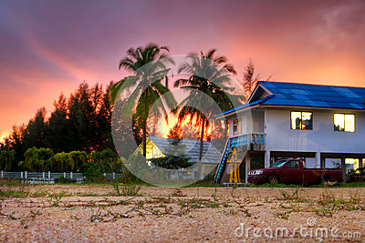 Tropical scenery of small Thai village at sunset