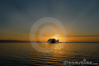 Tropical sunrise over island