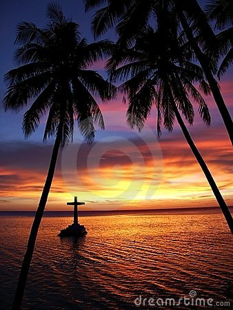 Tropical Sunset with Cross and Trees Silhouette