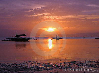 Tropical sunset with fishing boats