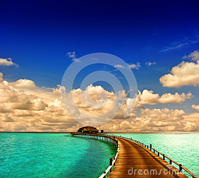 Free Tropical Sunset Seascape. Overwater Bungalow With Jetty Stock Photography - 39348752
