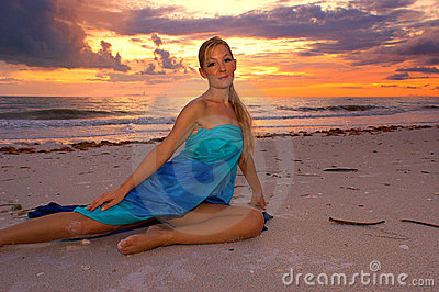 Tropical sunset with woman