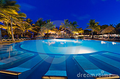 Tropical swimming pool at night