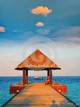 Free Tropical Thatched Roof Pavilion Sunset, Maldives Royalty Free Stock Photo - 104815275