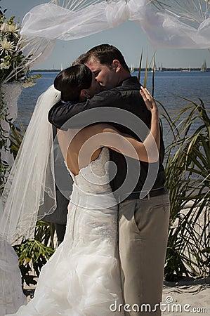 Tropical wedding couple kiss