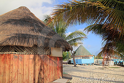 Tropical wood hut palapa in Cancun Mexico