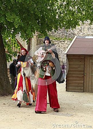 Troubadours on stilts Editorial Photo