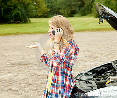 Trouble with the car engine, girl phoning to hep