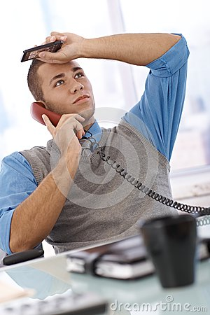 Troubled businessman on call