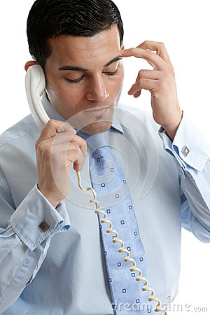 Troubled or depressed businessman making call