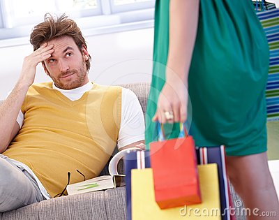 Troubled man and shopaholic woman